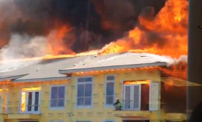 Man on top of burning complex Fire - WATCH NOW!