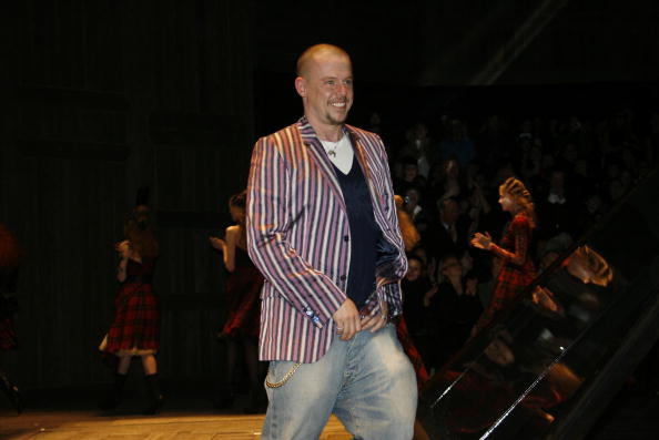 "Alexander McQueen walks the catwalk at his ""Widows of Culloden"" show. Photo via Michel Dufour/WireImage."